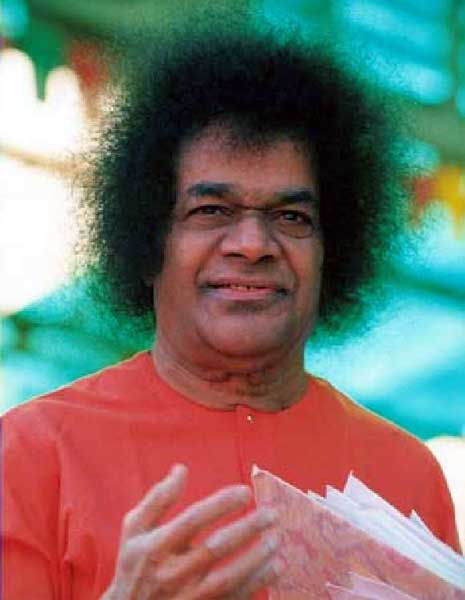 Sathya Sai Baba at Whitefield, holding letters, blessing devotees