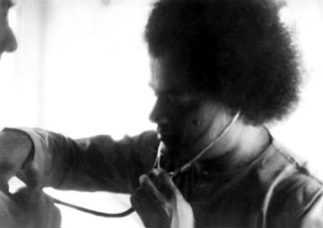Sathya Sai Baba with stethoscope