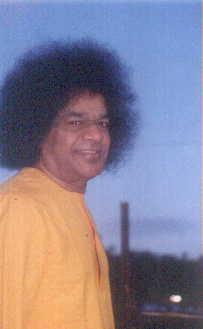 Bhagavan Sri Sathya Sai Baba in yellow robe