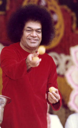 Sathya Sai Baba despatching laddus to students